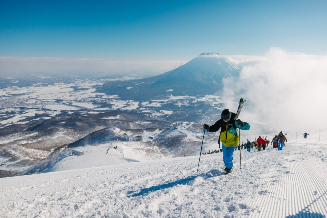 Hiking to the peak in Hirafu with Mount Yotei behind